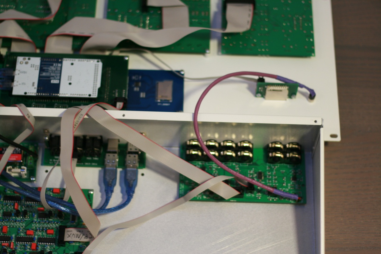 Part of bottom and lid. The PCB with all the phono sockets is the VCA board.